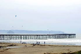 kite flying near the pier